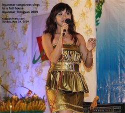 Myanmar songstress singing to a full house of Myanmar students & friends. Toa Payoh Vets