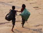 Carefree. Angkor Wat kids, Cambodia. Bags of used canned drinks. Toa Payoh Vets